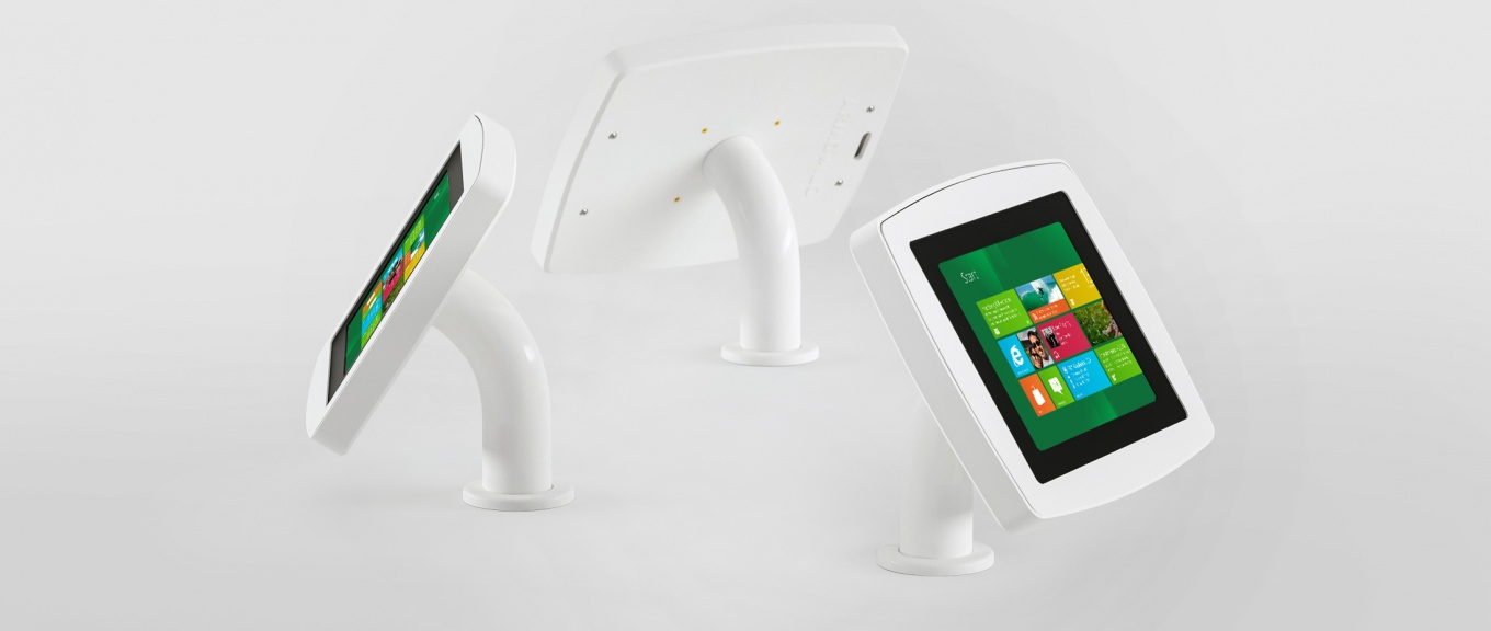 A banner showing views of the Armodilo Original Surface table mount tablet and iPad enclosure.